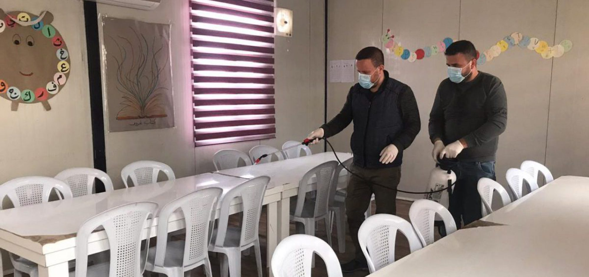 JRS staff disinfecting the community centre in Qaraqosh, Iraq.