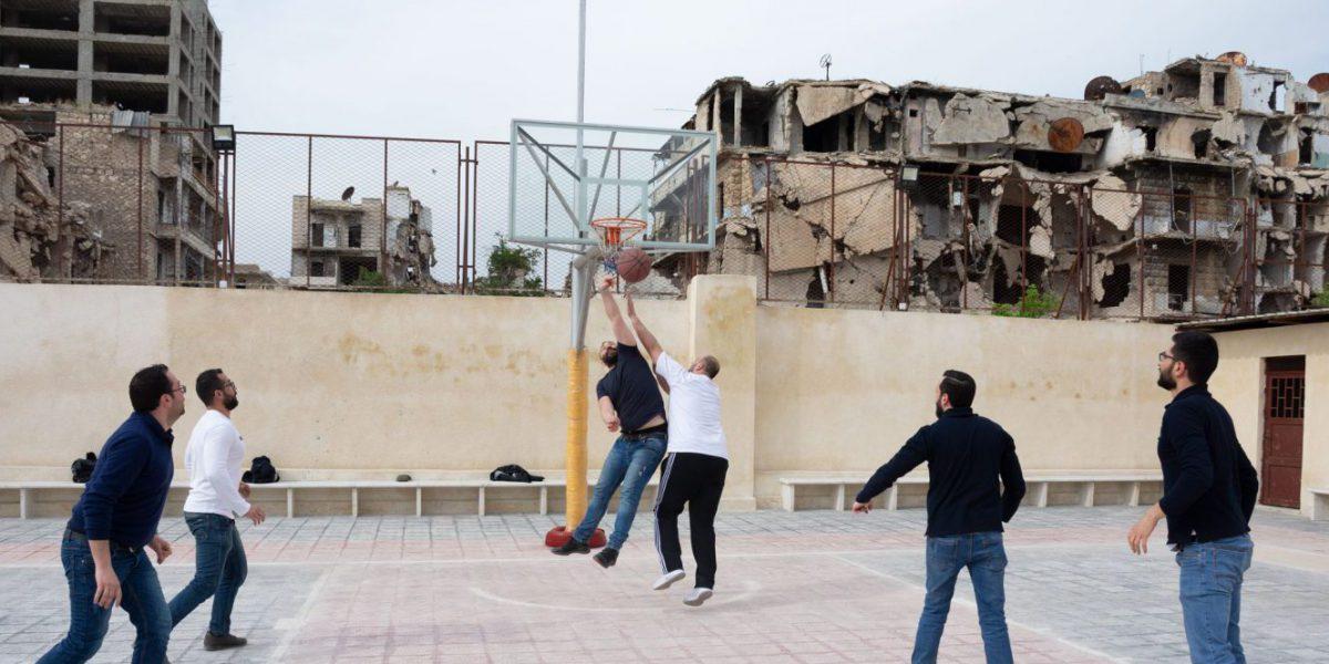 JRS staff enjoying a break in a ruined Aleppo, Syria.