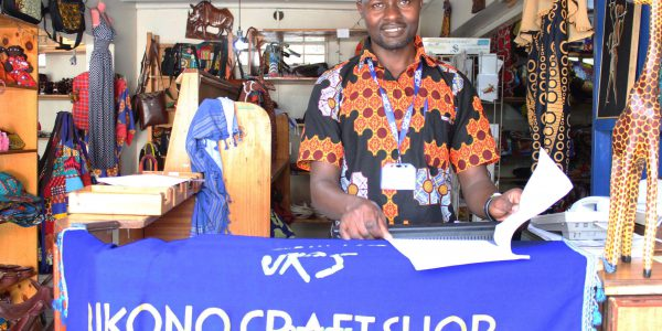 Teddy Salimo runs the JRS Mikono shop, which sells refugee-made handicrafts.