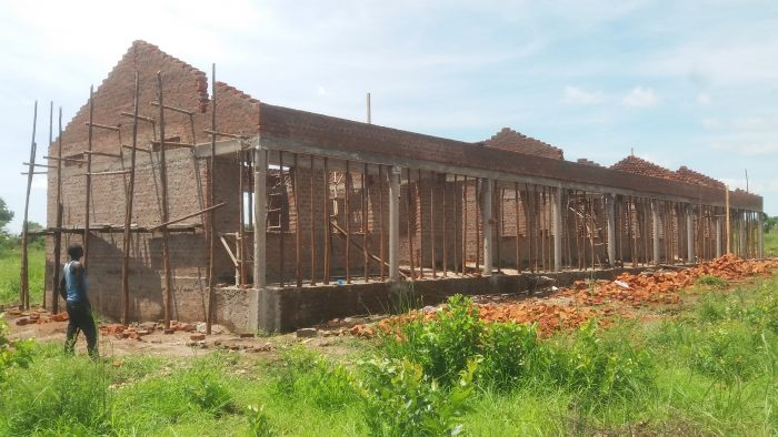 Four-classroom block construction at the Nyumanzi Secondary School