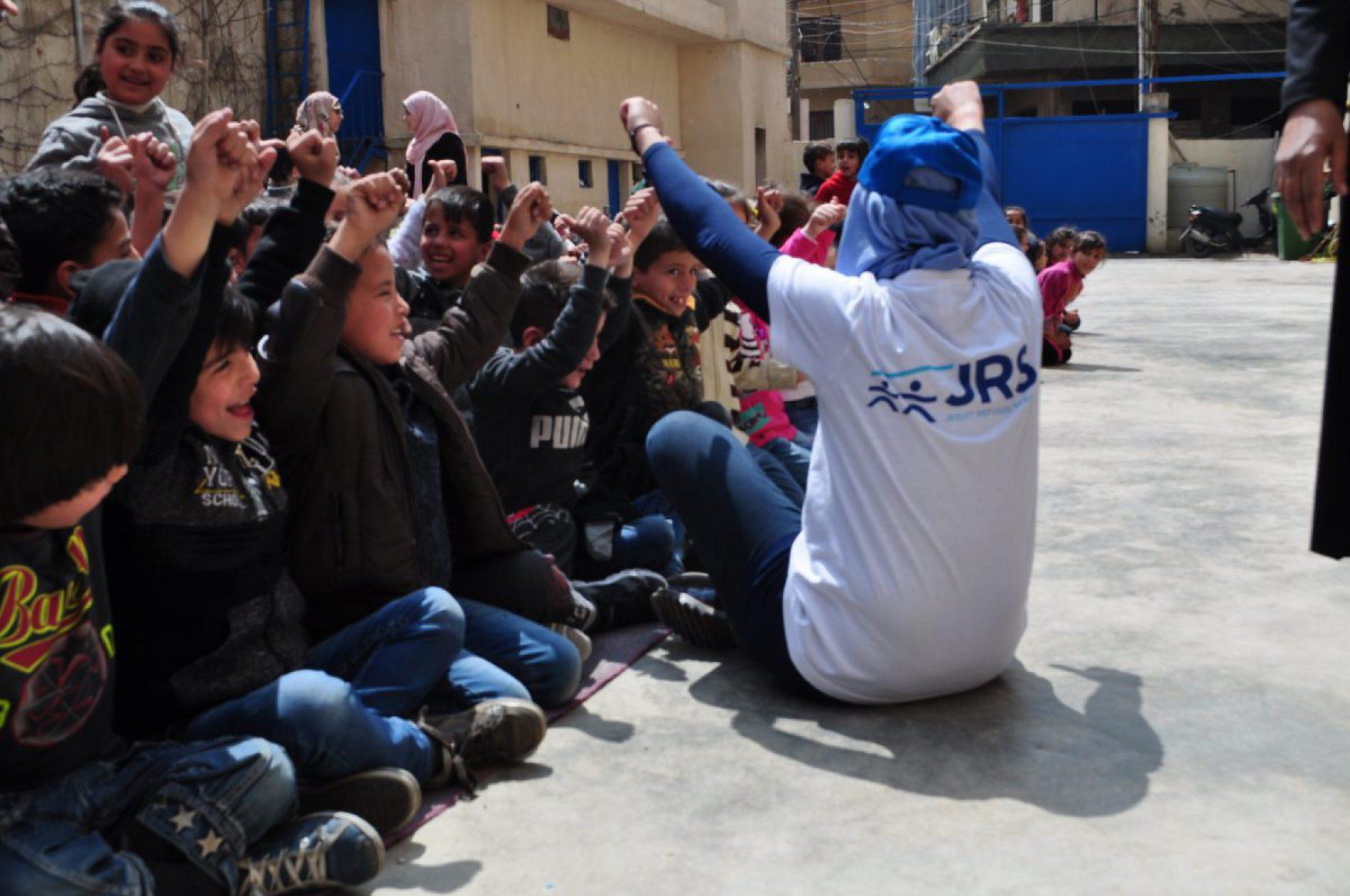 A JRS teachers entertain students