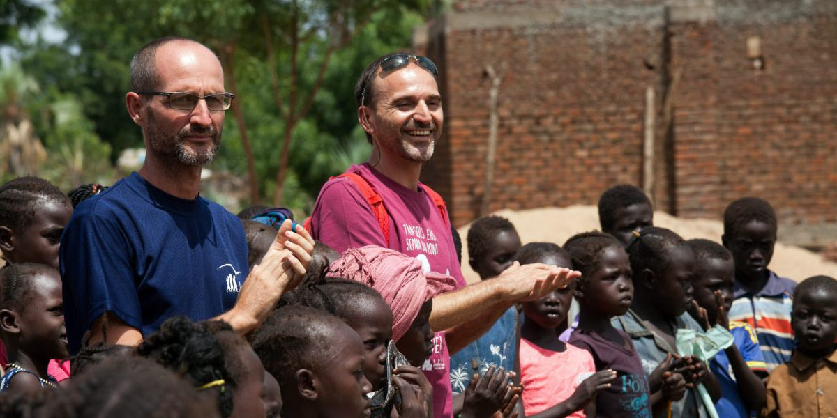 Fr Pau Vidal with and at that time Education Coordinator, Fr Alvar Sanchez SJ, at the Gulawein school, in Maban, South Sudan. Around 200 children attend this school supported by JRS, which is building new classrooms, providing daily food and paying teachers. (Photo by Albert Gonzalez Farran)