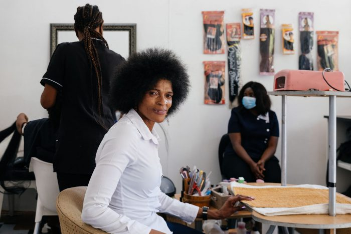 Alina Mofokeng at Thembelihle Hair & Beauty Salon in Pretoria, which she established after successfully completing the beauty course offered by the Jesuit Refugee Service. (James Puttick / New Frame)